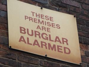 a burglar alarm sign