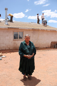 an old woman's home being repaired by some people
