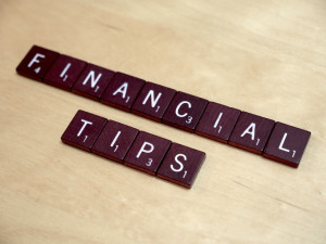 """Scrabble tiles spelling out """"FINANCIAL TIPS"""""""