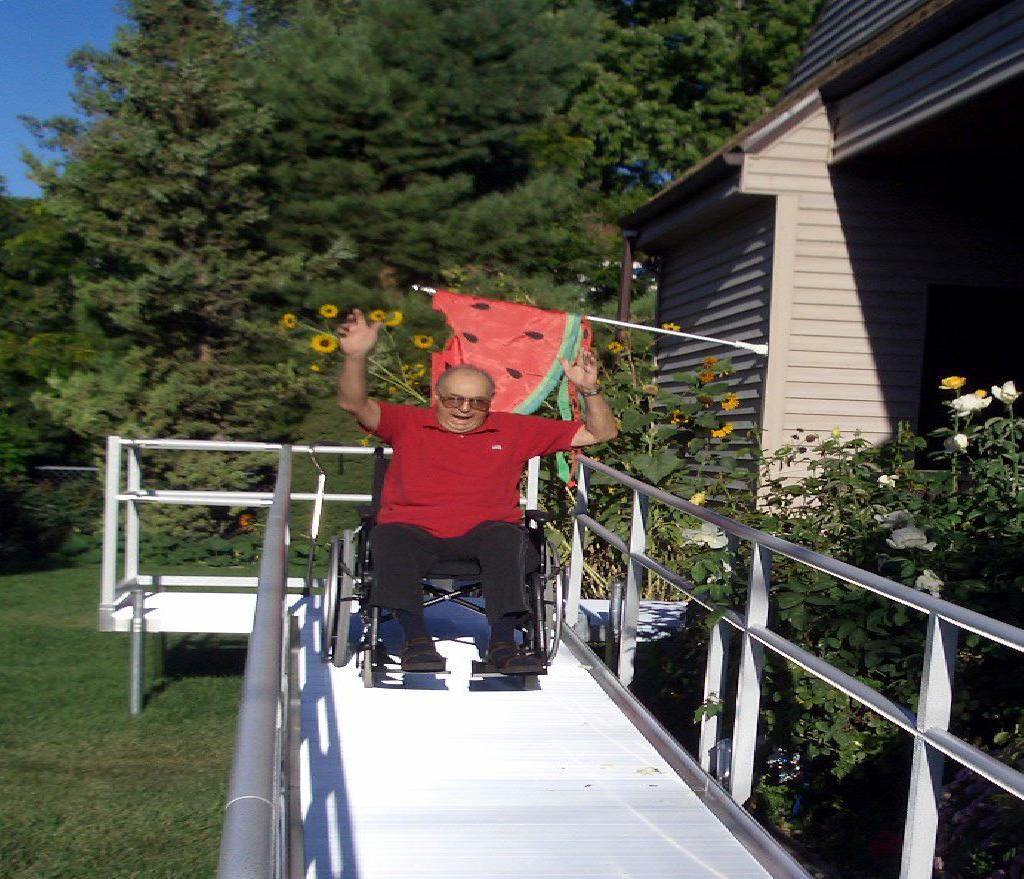 Senior trying out his new wheelchair ramp