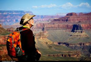 hiker looking at Grand Canyon