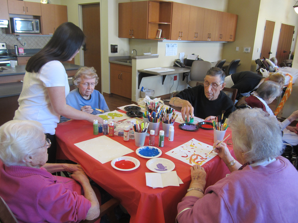 Helping seniors painting at the senior citizen community.