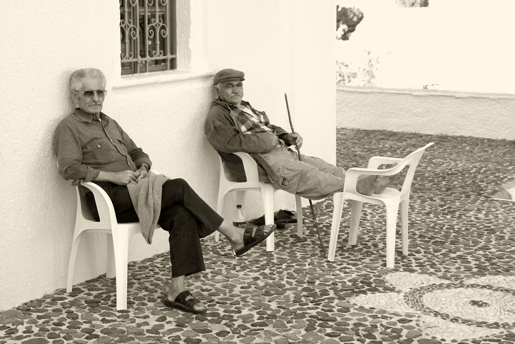 Old men resting after the exercise.