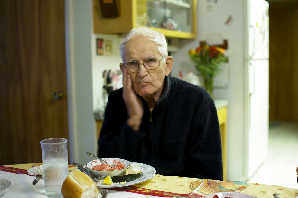Grandpa eating healthy breakfast.