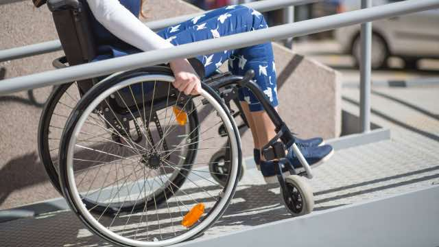 Person With Limited Mobility Using Wheelchair Ramp
